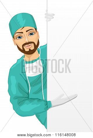 young surgeon green scrub presenting empty banner