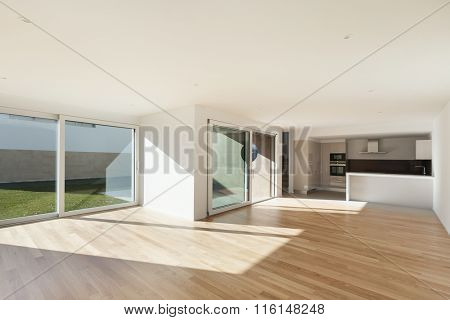 interior of a modern apartment, domestic kitchen in large room, hardwood floor