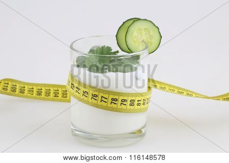 Glass With Yoghurt Tied Up By A Measuring Tape