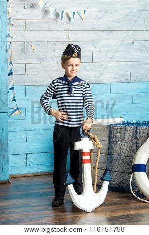 boy holding anchor