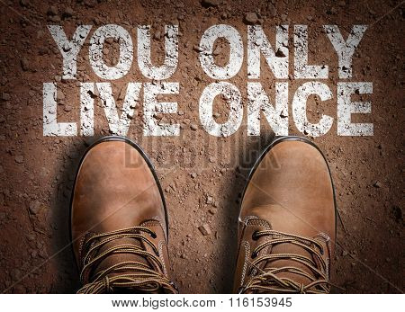 Top View of Boot on the trail with the text: You Only Live Once