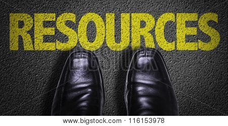 Top View of Business Shoes on the floor with the text: Resources