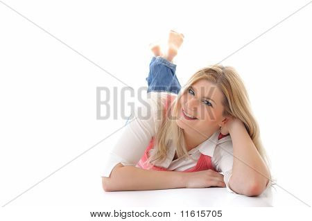 Young Casual Smiling Woman Lying On The Floor Isolated On White Background