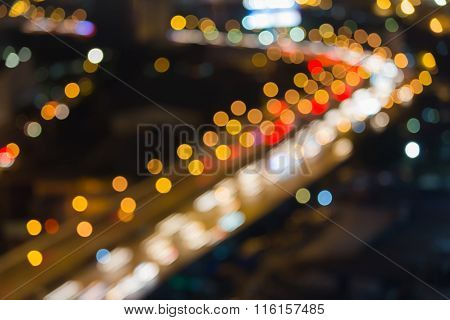 Blurred bokeh light background city highway curved