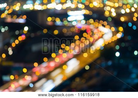 Blurred bokeh light background city highway curved at night