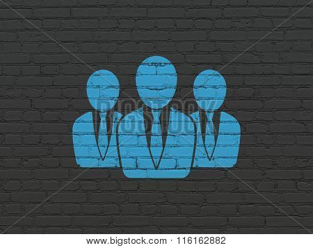 Marketing concept: Business People on wall background