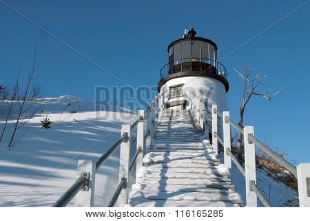 Snow Covered Stairway Leads to Lighthouse