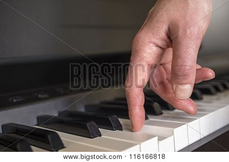 Fingers Click On The Piano Keys
