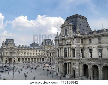 PARIS, FRANCE - AUGUST 28 2013: - The main courtyard of the Louvre Museum