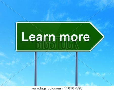 Education concept: Learn More on road sign background