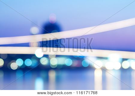 Blurred view of city on a river shore