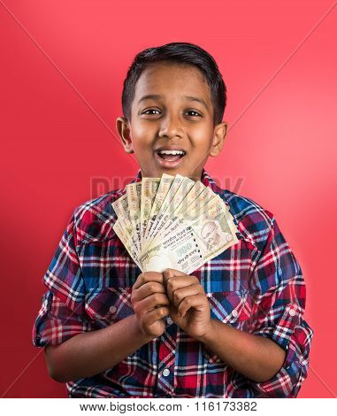 indian kid holding currency notes, indian kid and money, indian kid with 500 rupee note fan, indian