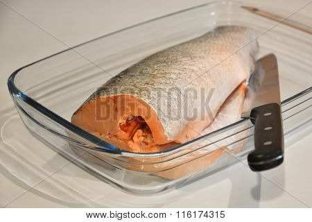 Fish For Cooking And Knife In A Glass Tray