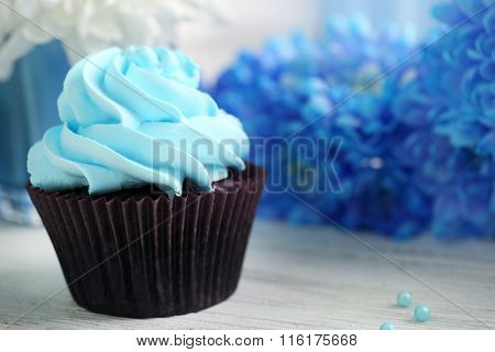 Cupcake on wooden table