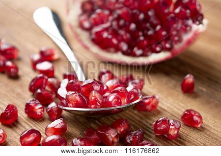 Pomegranate Seeds In A Spoon