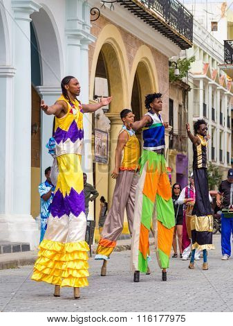 HAVANA,CUBA- JANUARY 24,2016 : Street performers dancing on stilts on a beautiful Old Havana square