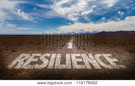 Resilience written on desert road