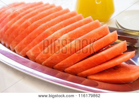 Sliced watermelon on a dish.