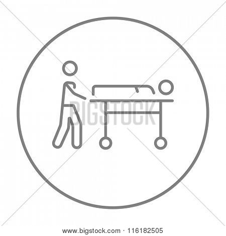 Man pushing stretchers line icon.