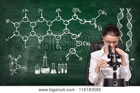 Woman Studying Chemical Sample