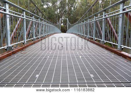Steel Suspension Footbridge Over River