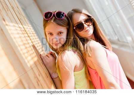 Two beautiful blond teenage girls having fun happy smiling