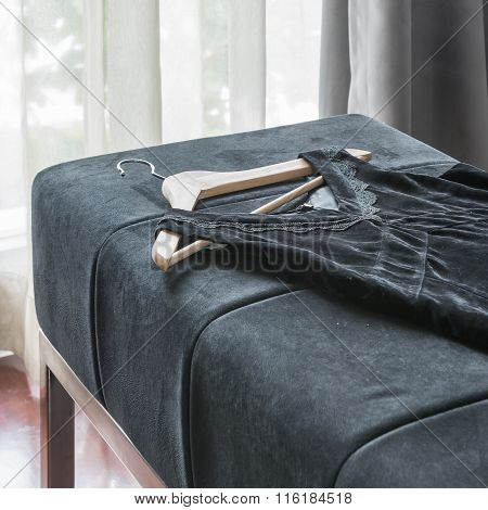 Black Dress With Wooden Coat Hanger