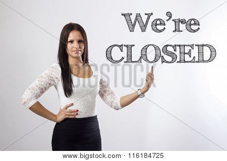 We're Closed - Beautiful Businesswoman Pointing