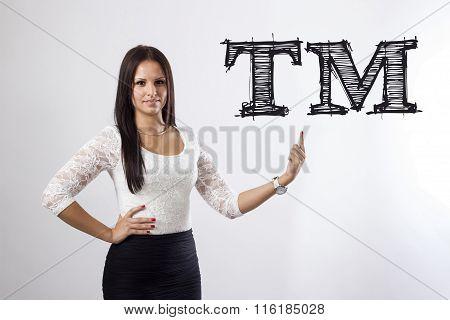 Tm Trade Mark - Beautiful Businesswoman Pointing