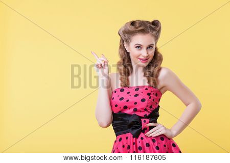 Pretty slim girl is presenting something interesting