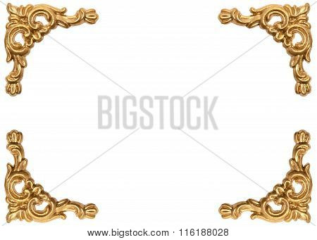 Golden corners of carved baroque style picture frame on white background