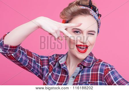 Cute young woman is gesturing positively