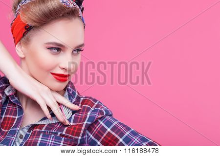 Cheerful young woman is posing with joy