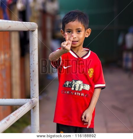 Poor Cambodian Boy Shows Victory Sign