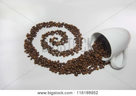 Spilled Coffee Beans From The White Ceramic Cup A Beautiful Pattern On White Background