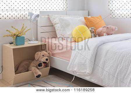 Kid's Bedroom With Colorful Pillows And Dolls