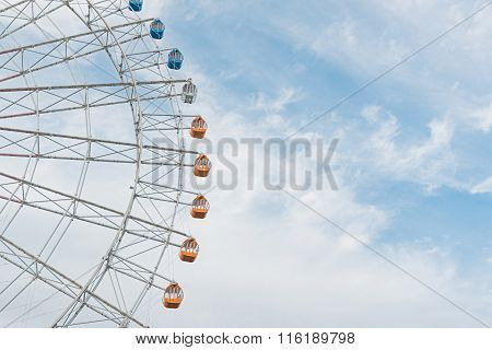Half Of The Ferris Wheel Against Sky.