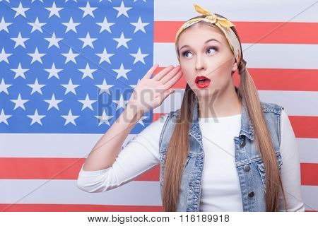 Cheerful girl near the symbol of usa