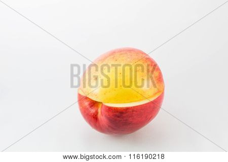 A Red Apple Cut Into Two Halves And Articulate.