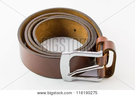 Old Leather Belt Roll On White Background.