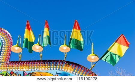 Colorful Flags And Lights At An Amusement Park