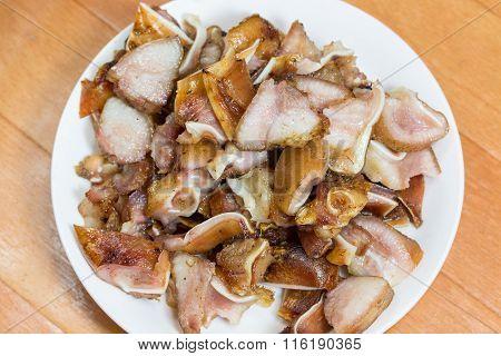 Grilled Pork Ears On White Plate / Thai Food.