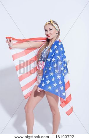 Attractive young woman is evincing her patriotism