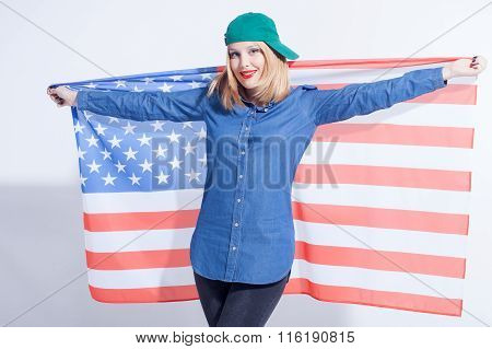 Beautiful young woman is expressing her patriotism