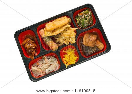 Japan Food Set Of Onion Fritter And Other In A Box Isolated On White / Japan Food (bento).