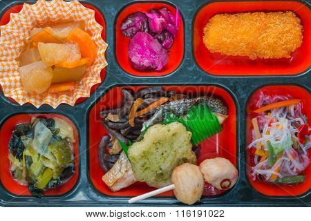 Japan Food Set Of Salmon Grilled And Other In A Box Isolated On White / Japan Food (bento).