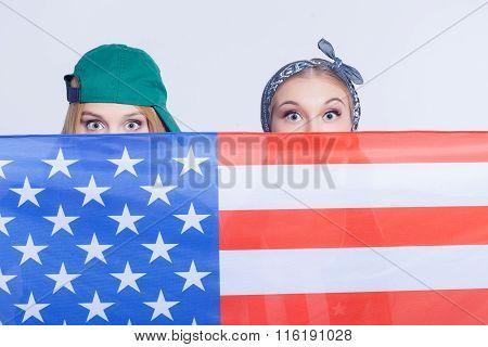 Attractive female American friends are making fun