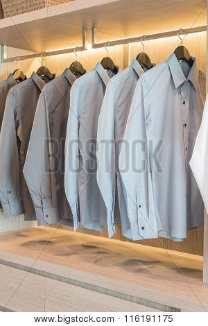 Row Of Shirts Hanging On Rail
