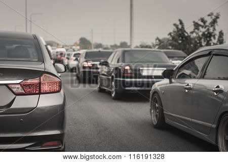 Traffic Jam With Row Of Cars On Expressway During Rush Hour , Morning Fog Light