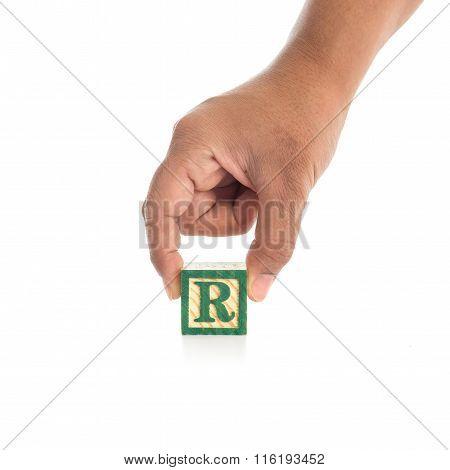 Hand Holding Colorful Alphabet Blocks